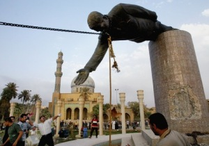 Removal of statue of Saddam Hussein in al-Firdos Square on 9 April 2003. Photo by Mirrorpix/Getty Images